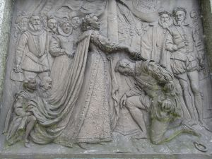 Queen Elizabeth I knighting Francis Drake from the Tavistock Monument (image in the public domain from Wikimedia Commons)
