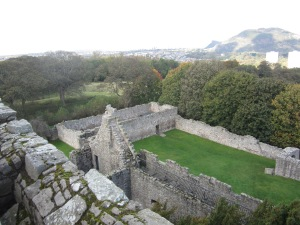 View to the north of Craigmillar Castle.  The roofless church is on the top left.  (Photo by the author)