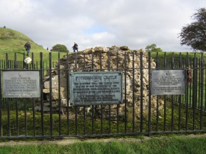 All that is left of the masonry of Fotheringhay Castle.  Plaques commemorate King Richard III on the left and Mary Queen of Scots on the right (Photo by the author)