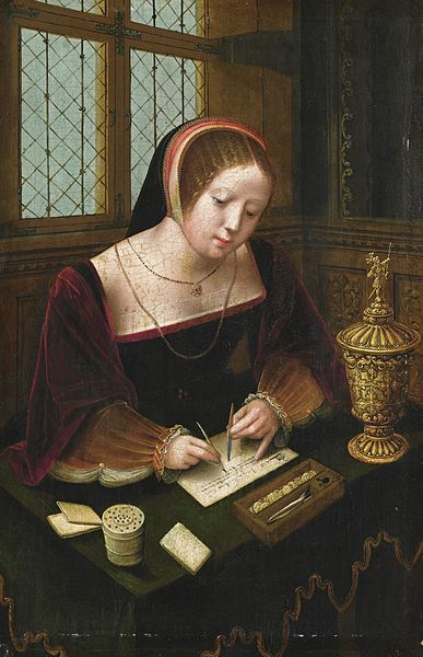 A_lady_writing_at_a_desk